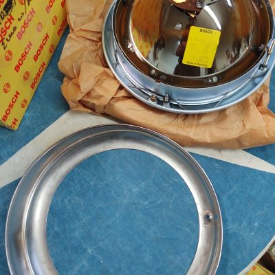 Mercedes W120 Bosch Headlight Complete Assembly with Euro Chrome ring for the Ponton NOS